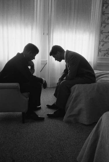 1960 | In a Los Angeles hotel suite, John F. Kennedy confers with his brother and campaign manager Bobby during the Democratic National Convention, at which JFK was picked as the 1960 party nominee. Originally published in the July 25, 1960, issue of LIFE.