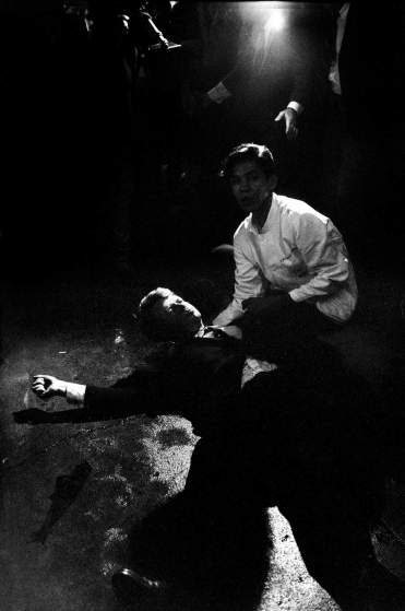 1968 | Senator Robert Kennedy lies in a pool of his own blood on the floor of the kitchen at Los Angeles' Ambassador Hotel, June 5, 1968, after being shot by Jordanian-born assassin Sirhan Sirhan. A dazed, frightened hotel busboy, Juan Romero, tries to comfort the mortally wounded presidential candidate, who died hours later. Robert Kennedy was 42 years old. Originally published in the June 14, 1968, issue of LIFE.