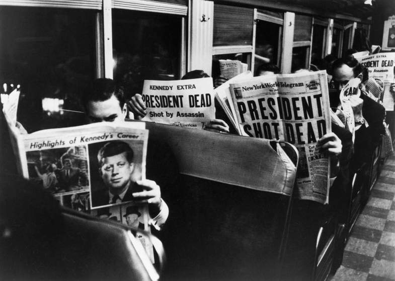 1963 | New York Commuters read of John F. Kennedy's assassination, November 1963. This Carl Mydans photo did not appear in LIFE when the magazine published as a weekly, but has been printed in later books.