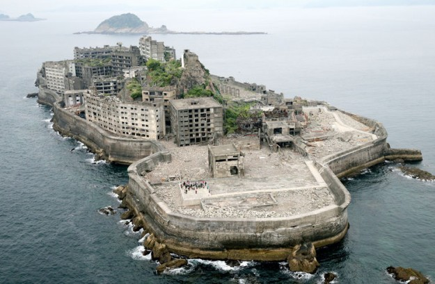 NAGASAKI, JAPAN - APRIL 23: (CHINA OUT, SOUTH KOREA OUT) In this aerial image, Hashima Island, commonly known as the battleship island is seen on April 23, 2015 in Nagasaki, Japan. The Island had been a coal complex and more than 5,000 people resided in 1960s, now uninhabited and only accept reserved visitors. (Photo by The Asahi Shimbun via Getty Images)