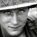 An-American-soldier-wears-a-hand-lettered-War-Is-Hell-slogan-on-his-helmet-Vietnam-1965۲