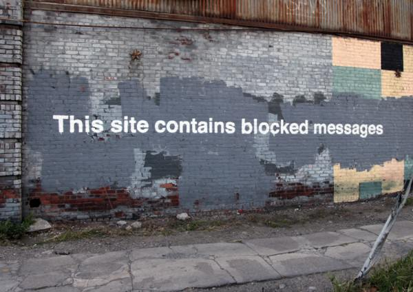 By-Banksy-This-site-contains-blocked-messages.-In-Greenpoint-New-York-USA-1-600x424