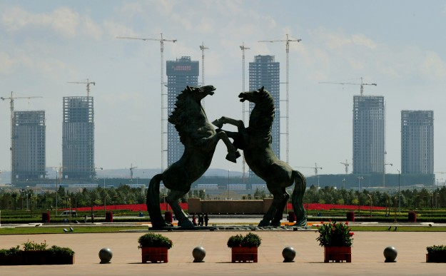 "A general view shows the main square in the city centre of Ordos, Inner Mongolia on September 12, 2011. The city which is commonly referred to as a ""Ghost Town"" due to it's lack of people, is being built to house 1.5 million inhabitants and has been dubbed as the ""Dubai of China"" by locals. AFP PHOTO/Mark RALSTON (Photo credit should read MARK RALSTON/AFP/Getty Images)"